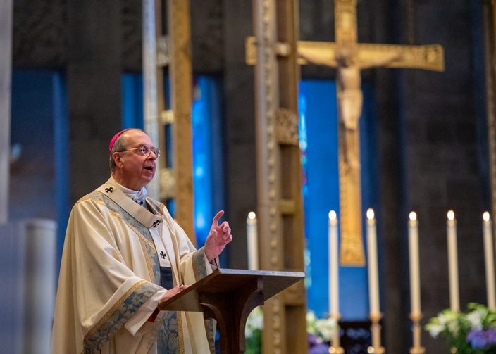 Archbishop William E. Lori of Baltimore delivers Easter Mass homily in the nearly empty Cathedral of Mary Our Queen. Archbishop Lori is among the U.S. church leaders who have released guidelines for reopening parishes. (CNS photo/Kevin Parks, Catholic Review)