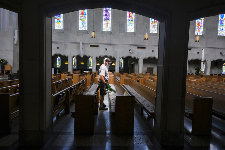 Mike Decker of Nashville, Tenn., applies an electrostatic disinfectant at Christ the King Church May 15, 2020. Bishop J. Mark Spalding has reinstated the public celebration of Mass in the diocese at the discretion of pastors, effective May 18. (CNS photo/Rick Musacchio, Tennessee Register)