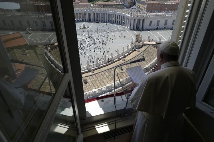 Pope Francis greets the faithfulfrom the window of his studio overlooking St. Peter's Square on May 31. The pope led the Sunday prayer from his window for the first time in three months, after the square was reopened.(CNS photo/Vatican Media)