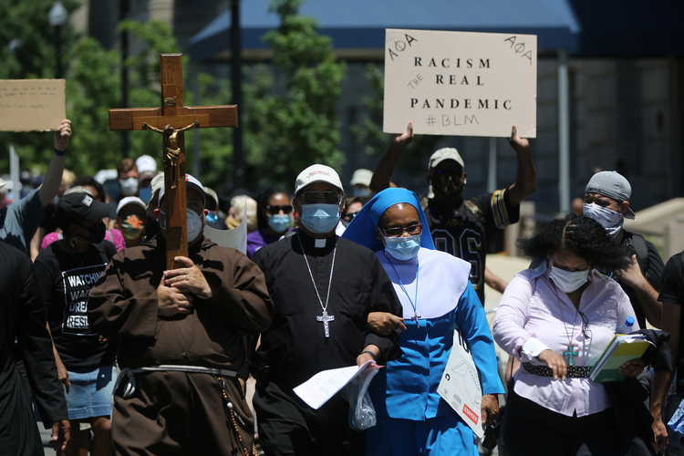 Washington Auxiliary Bishop Roy E. Campbell walks with others toward the National Museum of African American History and Culture in Washington, D.C., on June 8. (CNS photo/Bob Roller)