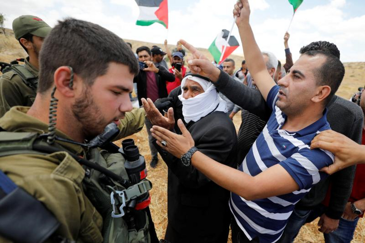 Palestinians argue with Israeli soldiers during a June 19, 2020, protest near Hebron, West Bank. (CNS photo/Mussa Qawasma, Reuters)