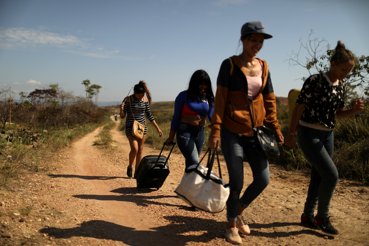 Venezuelan migrants walk along a trail into Brazil, in the border city of Pacaraima, Brazil, in April 2019. (CNS photo/Pilar Olivares, Reuters)