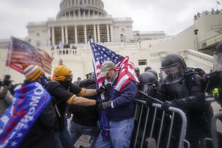 In the wake of the attack on the U.S. Capitol on Jan. 6, how can we achieve national unity and justice without being vengeful or dominative? (AP Photo/John Minchillo, File)