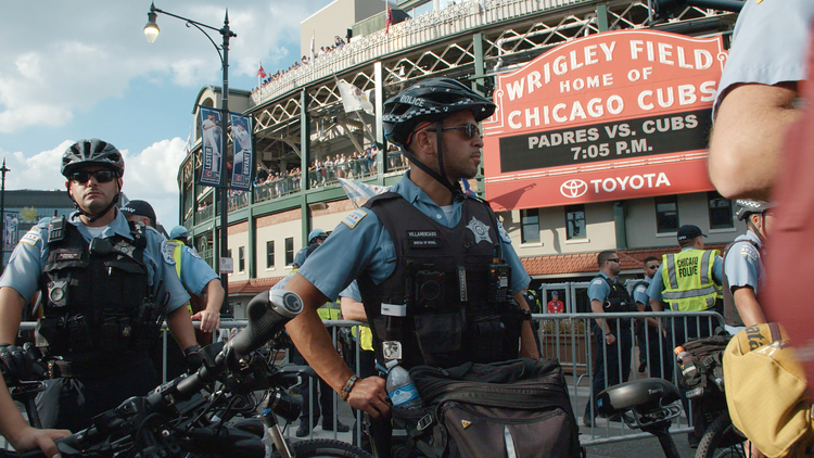 Police stand outside of Wrigley Field. (Chicago Story Film, LLC)