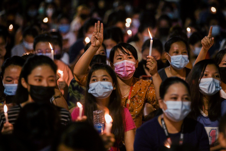 People hold candles as they take part in an anti-coup protest in Yangon, Myanmar, March 14, 2021. (CNS photo/Reuters)