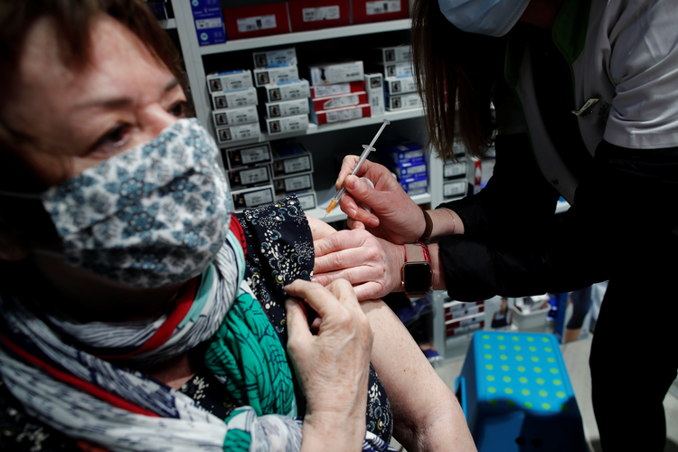 A pharmacist administers the AstraZeneca Covid-19 vaccine to a patient in a pharmacy in Paris on March 19, 2021. (CNS photo/Benoit Tessier, Reuters)