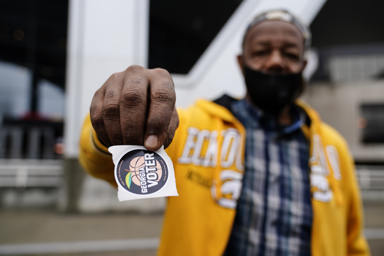 Gary Ragland, 64, votes for the first time during early voting in Atlanta on Oct. 28, 2020. (AP Photo/Brynn Anderson)