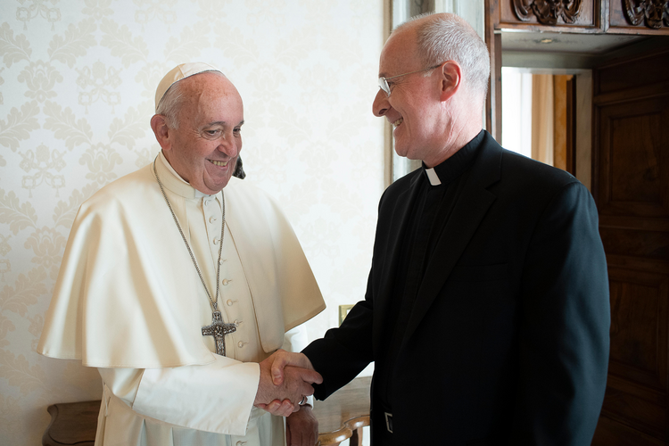 Pope Francis greets Jesuit FatherJamesMartin, author and editor at large of America magazine, during a private meeting at the Vatican Oct.1, 2019. (CNS photo/Vatican Media)