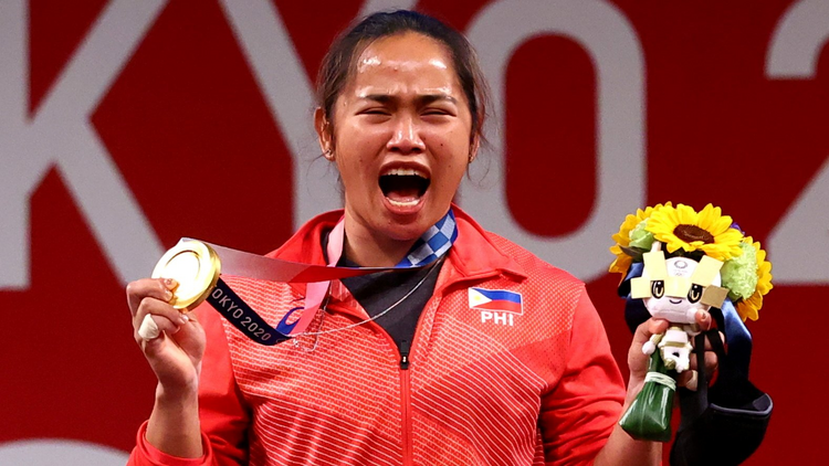 After winning the Philippines' first Olympic gold, Hidilyn Diaz thanked God and raised up her Miraculous Medal