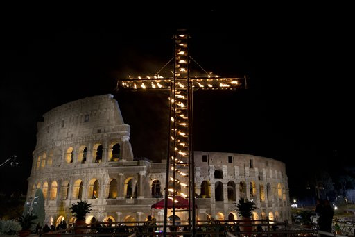 A view of the Colosseum prior to the arrival of Pope Francis to lead the Via Crucis (Way of the Cross) torchlight procession celebrated at the Colosseum on Good Friday in Rome, Friday, March 25, 2016 (AP Photo/Andrew Medichini).