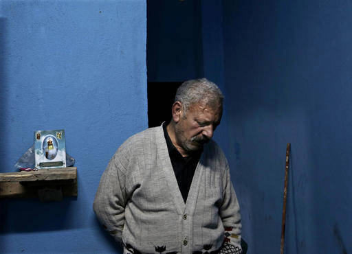Egyptian Christian Ezzat Yaacoub Ishak, who fled el-Arish in North Sinai with his family two days ago due to fighting, stands in his newly rented apartment, in Ismailia, 120 kilometers (75 miles) east of Cairo, Egypt, on Sunday, Feb. 26, 2017. (AP Photo/Nariman El-Mofty)