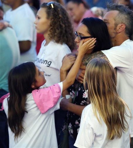 Friends and family grieve during a vigil to honor Pulse night club victim Corey Connell at Publix in College Park, Fla. (Stephen M. Dowell(/Orlando Sentinel via AP)