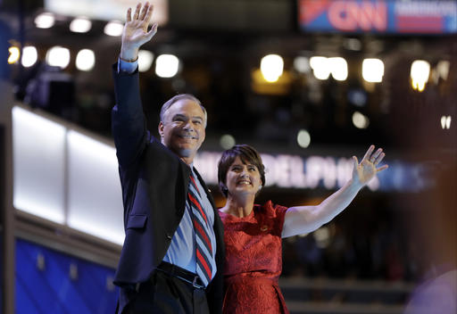 Democratic vice presidential candidate, Sen. Tim Kaine, D-Va., waves with his wife Anne Holton during the third day session of the Democratic National Convention in Philadelphia, Wednesday, July 27, 2016. (AP Photo/Matt Rourke)