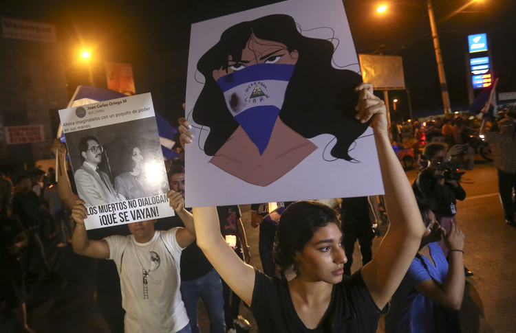 In this April 24, 2018 photo, demonstrators protest in honor of those who have died during anti-government protests in Managua, Nicaragua. (AP Photo/Alfredo Zuniga, File)