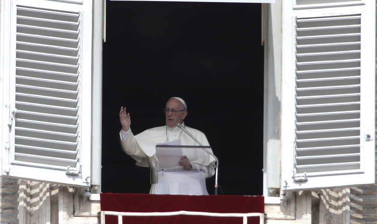 Pope Francis delivers his blessing during the Angelus noon prayer from the window of his studio overlooking St. Peter's Square, at the Vatican, on Sunday, Sept. 24, 2017. (AP Photo/Alessandra Tarantino)