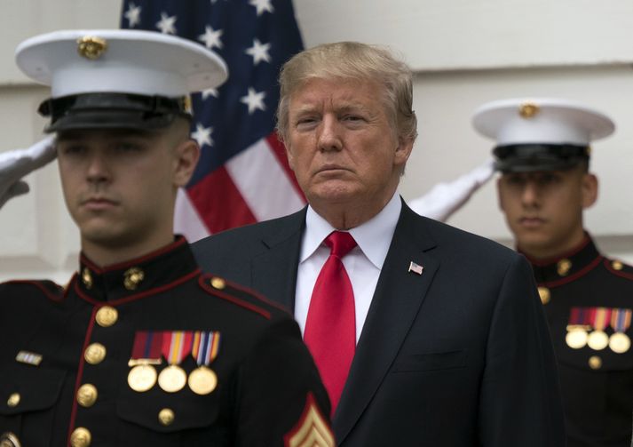 President Donald Trump stands behind and in front of members of a Marine honor guard as he greets Canadian Prime Minister Justin Trudeau and Sophie Gregoire Trudeau as they arrive at the White House on Oct. 11. (AP Photo/Carolyn Kaster)