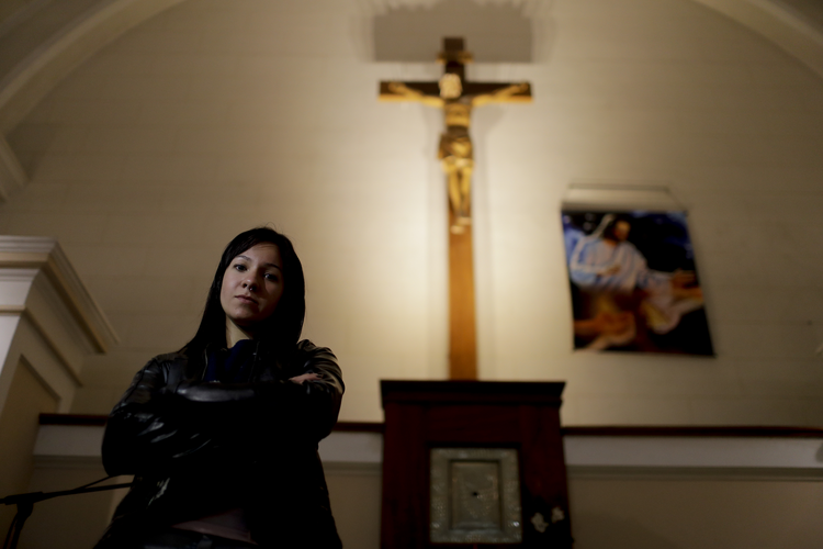"In this Oct. 11, 2017 photo, Yasmin Detez poses for a portrait inside San Jose Obrero church where Rev. Carlos Jose celebrated Mass in Caseros, in the province of Buenos Aires, Argentina. Detez, 25, says she was abused as a child by the Catholic priest. ""He'd make me sit on his lap and ask me if I had been naughty while he kissed my neck and fondled me,"" Detez said. (AP Photo/Natacha Pisarenko)"
