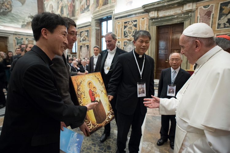Pope Francis meets participants in the International symposium on a nuclear-weapons-free world, at the Vatican, Friday, Nov. 10, 2017. (L'Osservatore Romano/Pool Photo via AP)