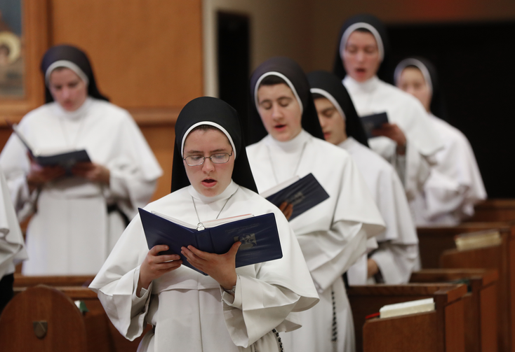 "In this Nov. 14, 2017 photo, sisters sing at the Dominican Sisters of Mary, Mother of the Eucharist campus in Ann Arbor, Mich. Their third and latest album, ""Jesu, Joy of Man's Desiring: Christmas with the Dominican Sisters of Mary,"" has muscled its way to the top of Billboard's classical chart and climbed nearly as high on the holiday chart. (AP Photo/Paul Sancya)"