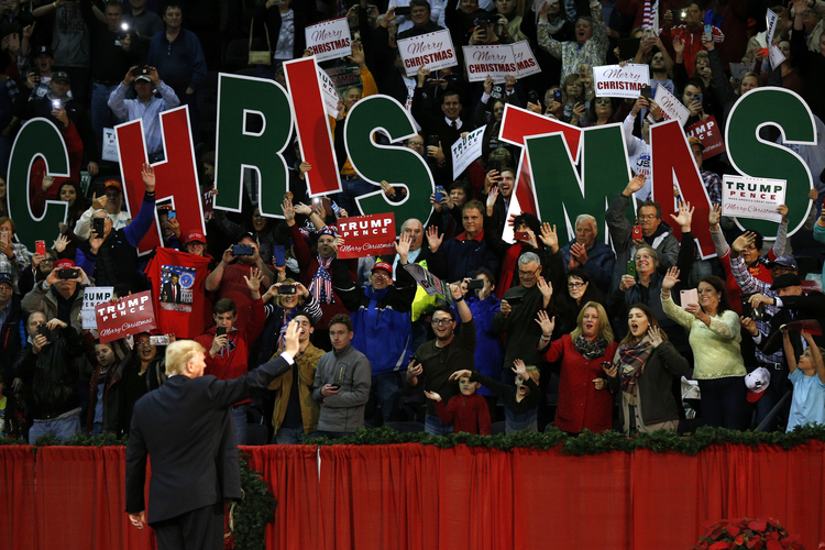 President Donald Trump waves to supporters during a rally in Pensacola, Fla., Friday, Dec. 8, 2017. (AP Photo/Jonathan Bachman)