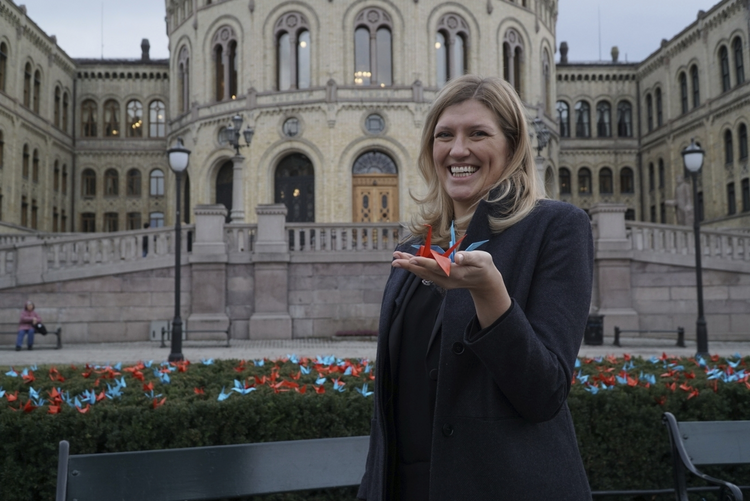 Beatrice Fihn, the executive director of the International Campaign to Abolish Nuclear Weapons (ICAN) holds two paper cranes in Oslo on Dec. 9. (AP Photo/David Keyton)