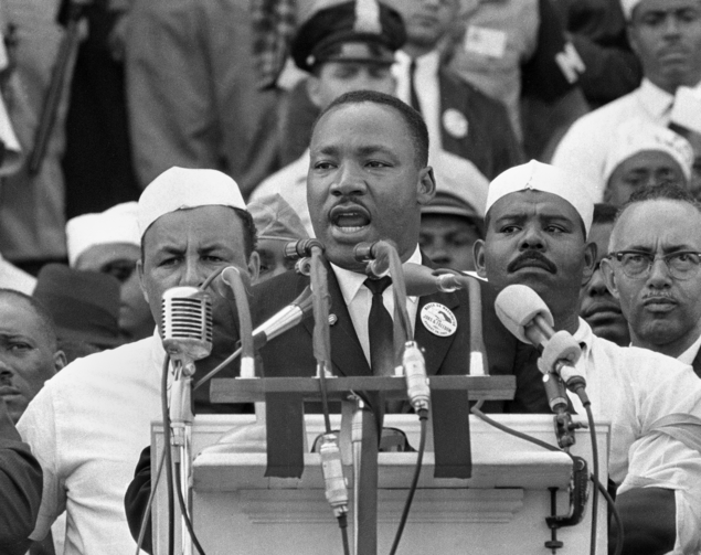 "In this Aug. 28, 1963, file photo, Dr. Martin Luther King Jr., head of the Southern Christian Leadership Conference, addresses marchers during his ""I Have a Dream"" speech at the Lincoln Memorial in Washington. (AP Photo, File)"
