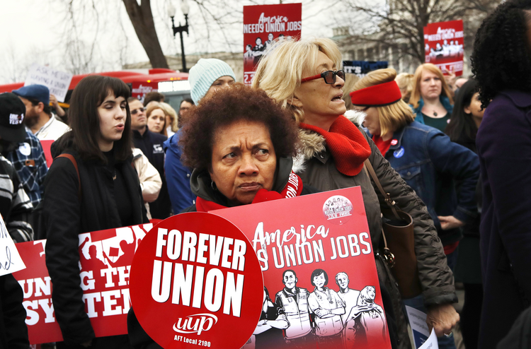 Betty Shadrick, of Albany, N.Y., center, with the United University Professions union, rallies in support of unions outside of the Supreme Court on Feb. 26 in Washington. The court is considering a challenge to an Illinois law that allows unions representing government employees to collect fees from workers who choose not to join. (AP Photo/Jacquelyn Martin)