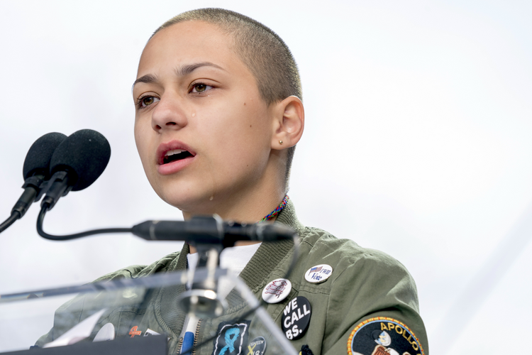 "Emma Gonzalez, a survivor of the mass shooting at Marjory Stoneman Douglas High School in Parkland, Fla., speaks at the ""March for Our Lives"" rally in support of gun control in Washington on March 24. (AP Photo/Andrew Harnik File)"
