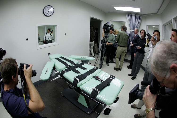 Journalists photograph the lethal injection facility at San Quentin State Prison in California in 2010. (AP Photo/Eric Risberg, File)
