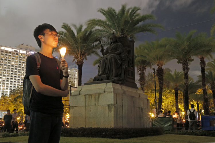 Thousands attended an annual candlelight vigil in Hong Kong on June 4 in Victoria Park, remembering the victims of the Tiananmen Square massacre in Beijing in 1989. (AP Photo/Kin Cheung)