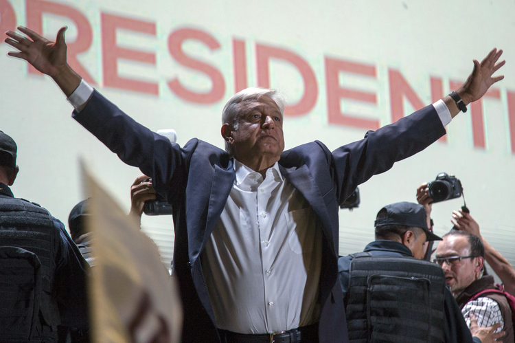 Presidential candidate Andres Manuel Lopez Obrador acknowledges his supporters as he arrives to Mexico City's main square, the Zocalo on July 1, 2018. (AP Photo/Anthony Vazquez)