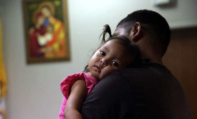 Honduras immigrant seeking asylum, Carlos Fuentes Maldonado holds his daughter Mia, 1, after they were reunited, Monday, July 23, 2018, in San Antonio. (AP Photo/Eric Gay)