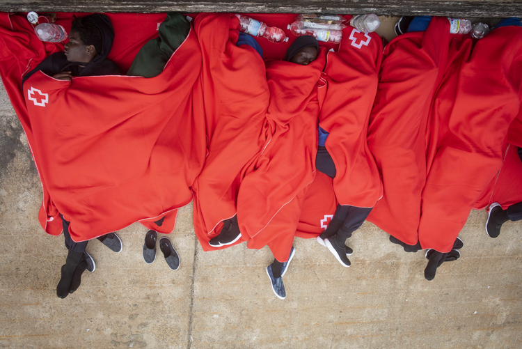 Migrants rest at the port of Tarifa, southern Spain, on July 27 after being rescued by Spain's Maritime Rescue Service. Authorities said 751 migrants were rescued from 52 dinghies trying to reach Spanish shores from northern Africa, this year's most popular route into Europe for human traffickers. (AP Photo/Marcos Moreno)