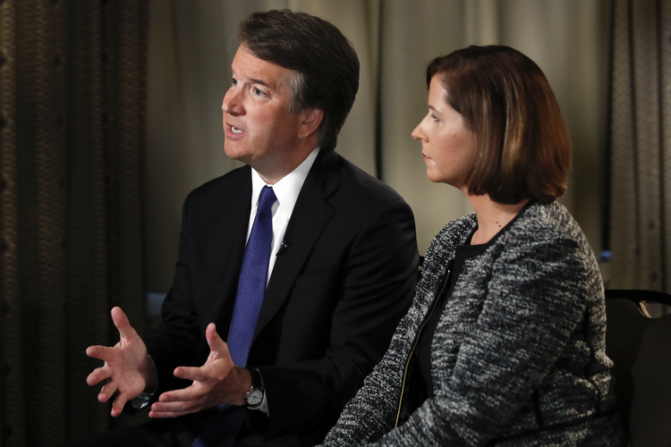 Brett Kavanaugh, with his wife Ashley Estes Kavanaugh, answers questions during a FOX News interview on Sept. 24 about allegations of sexual misconduct against the Supreme Court nominee. (AP Photo/Jacquelyn Martin)