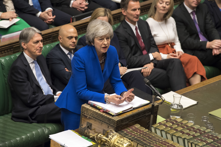 Britain's Prime Minister Theresa May speaking during Prime Minister's Questions at the House of Commons in London, on Dec. 19. Britain is due to leave the EU on March 29, but it remains unclear whether lawmakers will approve the divorce agreement negotiated with the bloc.(Mark Duffy/UK Parliament via AP)