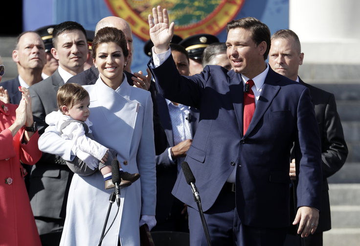 Florida Gov. Ron DeSantis waves during an inauguration ceremony with his wife Casey and son Mason on Jan. 8, in Tallahassee, Fla. (AP Photo/Lynne Sladky)