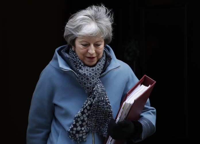 The staggering parliamentary defeat for Prime Minister Theresa May, seen here leaving 10 Downing Street on Jan. 23, pushed the country even further from safe dry land. (AP Photo/Alastair Grant)