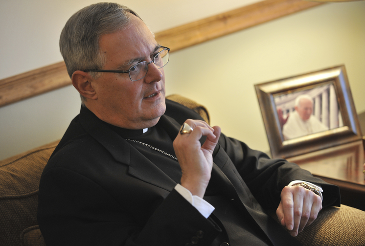 In this Nov. 22, 2009 file photo, Roman Catholic Bishop Thomas Tobin speaks to a reporter in Riverside, R.I. Tobin, Rhode Island's Roman Catholic bishop is facing backlash after tweeting Saturday, June 1, 2019 that Catholics should not support or attend LGBTQ Pride Month events. (AP Photo/Josh Reynolds, File)