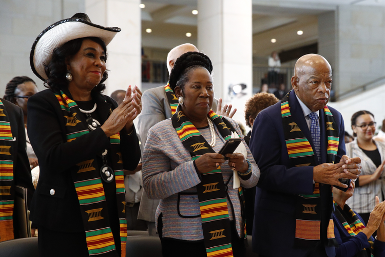 Rep. Frederica Wilson, D-Fla., Rep. Sheila Jackson Lee, D-Texas and Rep. John Lewis, D-Ga., at a ceremony to commemorate the 400th anniversary of the first recorded arrival of enslaved African people in America, on Sept. 10 on Capitol Hill in Washington. (AP Photo/Patrick Semansky)