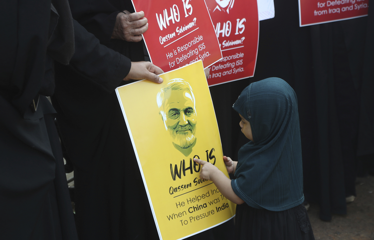 A Shiite Muslim girl points at a portrait of Iranian Gen. Qassem Soleimani, who was killed in a U.S. attack, during a protest against the United States in Mumbai, India, on Jan. 9. (AP Photo/Rafiq Maqbool)
