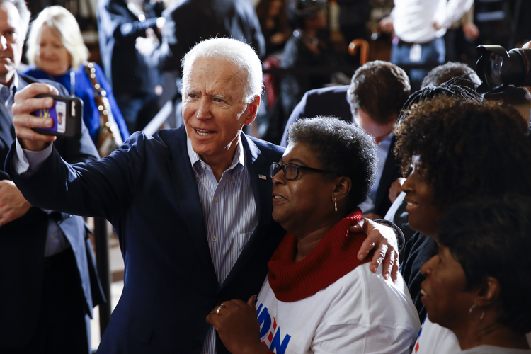 Democratic presidential candidate former Vice President Joe Biden meets with attendees during a campaign event, Wednesday, Feb. 26, 2020, in Charleston, S.C. (AP Photo/Matt Rourke)