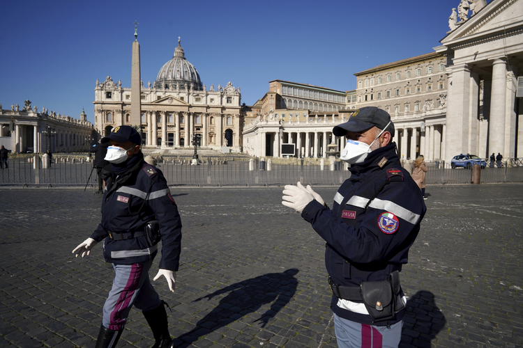 Police officers patrol an empty St. Peter's Square at the Vatican on Wednesday, March 11. (AP Photo/Andrew Medichini)