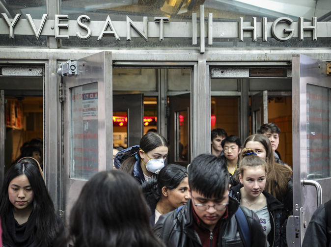 Students at New York City's Stuyvesant High School leave classes on March 13. Schools in New York City have since been closed for the rest of the academic year. (AP Photo/Bebeto Matthews, File)