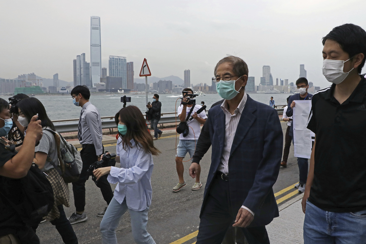 Former pro-democracy lawmaker Martin Lee leaves a police station in Hong Kong on April 18. Hong Kong police arrested at least 14 pro-democracy lawmakers and activists on charges of joining unlawful protests last year calling for reforms. (AP Photo/Kin Cheung)