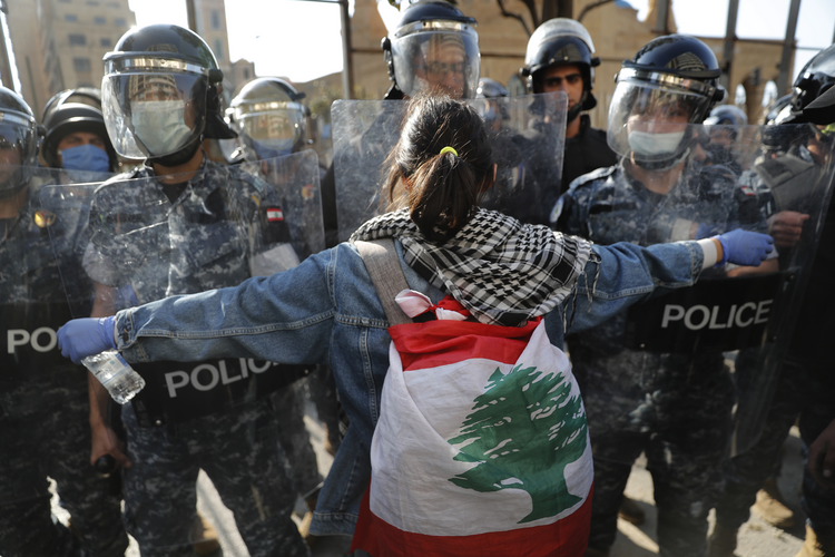 Image: An anti-government protester confronts security during a protest against the deepening financial crisis, in Beirut, Lebanon, on April 28. (AP Photo/Hussein Malla)