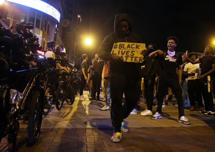 Protesters walk past a line of police in downtown Columbus, Ohio, on Thursday during a demonstration over the death of George Floyd in police custody Monday in Minneapolis. (Barbara J. Perenic/The Columbus Dispatch via AP)