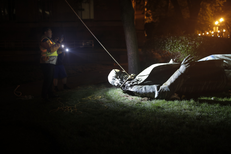 The statue of a Confederate general, Albert Pike, after it was toppled by protesters and set on fire in Washington, D.C., on  June 20. (AP Photo/Maya Alleruzzo)
