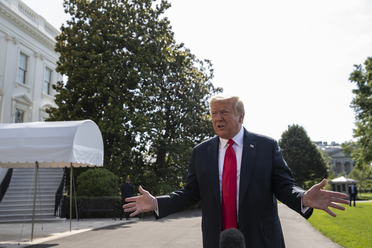 President Donald Trump speaks with reporters before departing on Marine One on the South Lawn of the White House, Tuesday, June 23, 2020, in Washington. (AP Photo/Alex Brandon)
