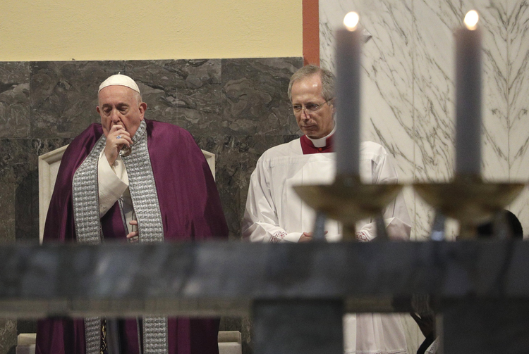 Pope Francis coughs inside the Basilica of Saint Anselmo prior to the start of a procession to the Basilica of Santa Sabina before the Ash Wednesday Mass in Rome on Feb. 26. (AP Photo/Gregorio Borgia)