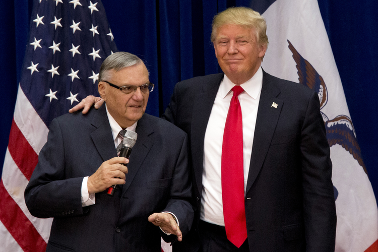 In this Jan. 26, 2016 photo, then-Republican presidential candidate Donald Trump is joined by Joe Arpaio, the sheriff of metro Phoenix, at a campaign event in Marshalltown, Iowa (AP Photo/Mary Altaffer).